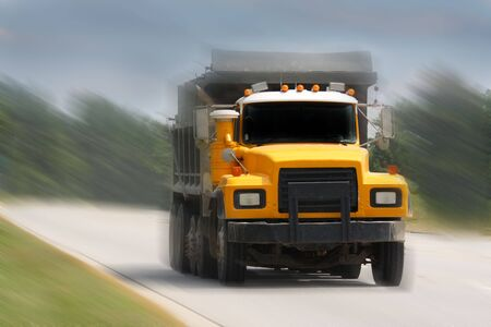 dump truck driving on road photo