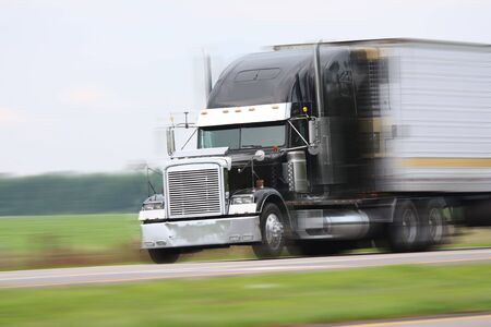 cargo truck driving on road photo
