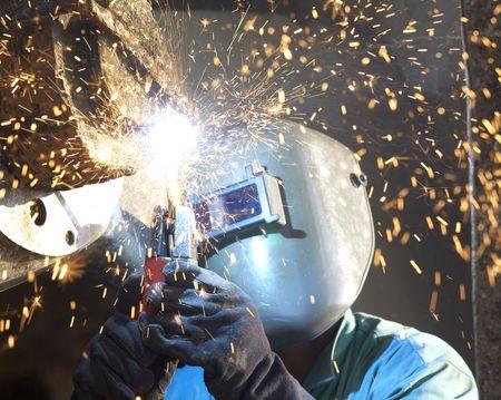 an arc welder working on a tub boat wheel Standard-Bild
