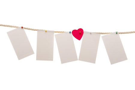 The paper hangs on a rope, isolated on a white background