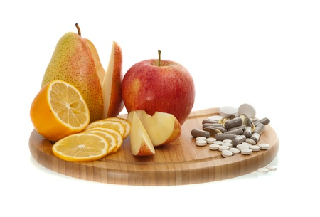 apple, pear, lemon and vitamins in pills