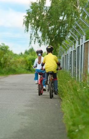 young boy and young girl on bike Stock Photo - 9877766