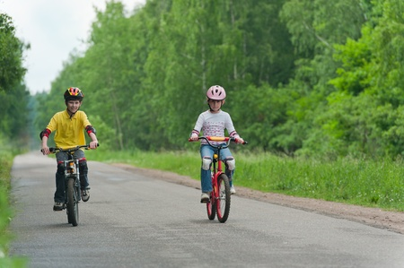 young boy and young girl on bike