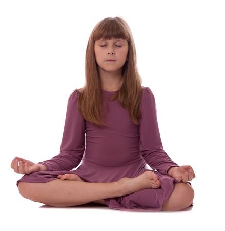 Girl sitting on floor meditating. Yoga. Lotus Position.  photo