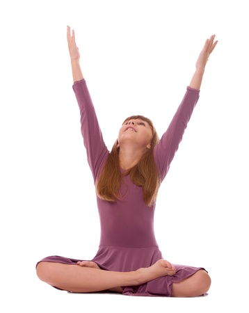 Young girl practicing yoga, isolated on white. photo