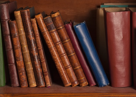 book binding: Antique books on bookshelf  Stock Photo