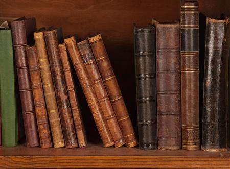 Antique books on bookshelf  Imagens