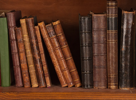library book: Antique books on bookshelf  Stock Photo