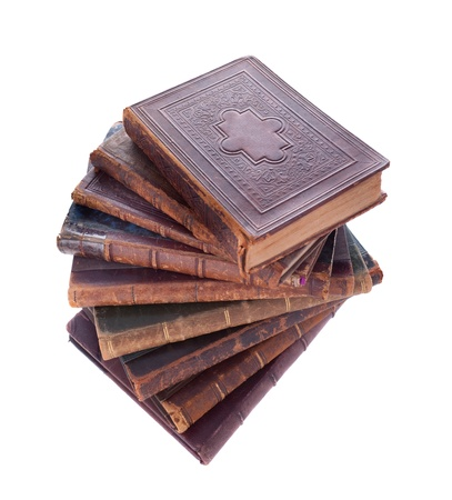Stack of nine antique books, isolated white background  photo