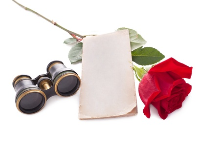 Theatre tickets and red rose isolated on white. photo