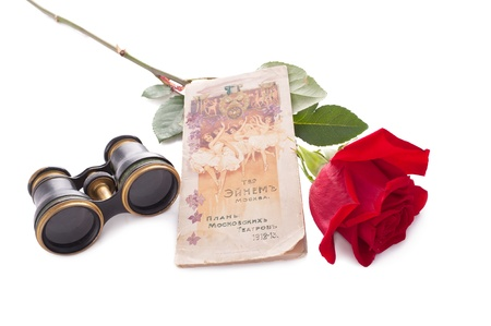 long stem roses: Theatre tickets and red rose isolated on white.