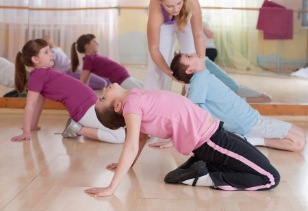 physical education: group of children engaged in physical training in the gym. Horizontal.