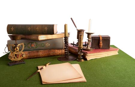 Desk with an open book and old stationery. Isolated on white. Stock Photo - 15976330