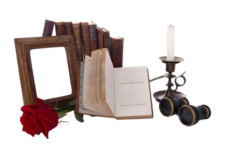 antique binoculars: Still life with antique books and picture frames. Isolated on white.