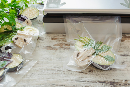 Raw vegetables and mushroom in vacuum package. Sous-vide, new technology cuisine. Horizontal.