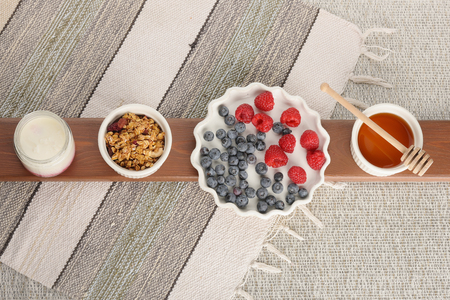 Series about granola, berry and greek yogurt suitable for a healthy breakfast, snack or dessert.