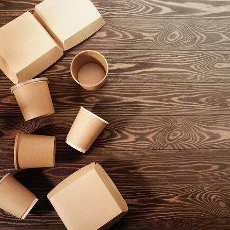 Biodegradable tableware on wooden background. Environmental protection. Secondary processing. The concept of zero waste.