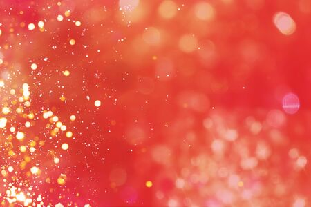 Festive red background with bokeh lights. Christmas backdrop.