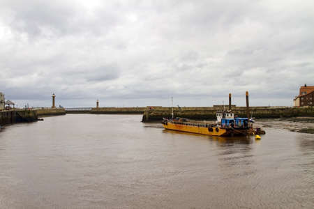 dredger: An old dredger in harbour at Whitby