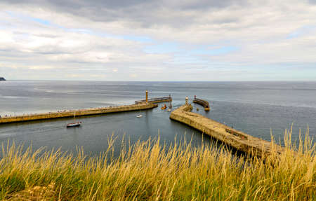 going out: View of boats going out to sea at Whitby harbour Stock Photo