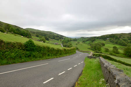 cumbria: Road meandering through the lake district in cumbria,England