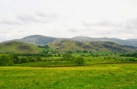 cumbria: Hills across fields in the lake district in cumbria