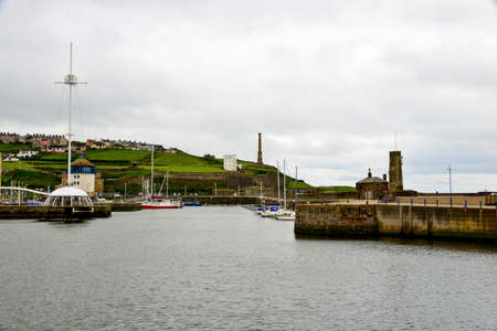 whitehaven: Whitehaven harbour with small boats in,on a cloudy day