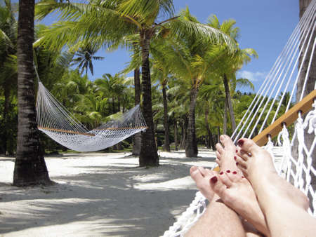 Couple relaxing on the beach in a Hammock on Bora Bora Island, Tahiti Stock Photo - 8138964