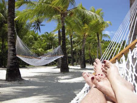 Couple relaxing on the beach in a Hammock on Bora Bora Island, Tahiti Stock Photo - 8138964