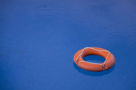 A lifebuoy floating on the water photo