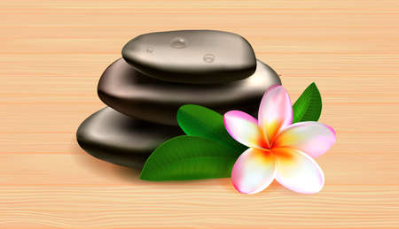 Spa stones green leaves and tropical flower on wooden table against grey background