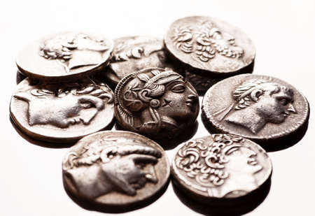 greek coins: Pile of ancient greek coins on reflective surface, closeup macro shot, selective focus Stock Photo