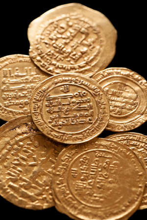 arabische letters: Ancient golden islamic coins with arabic letters, closeup macro shot, selective ficus, vertical