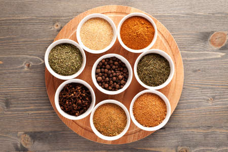 indian mustard: Set of spices on wooden cutting board top view Stock Photo