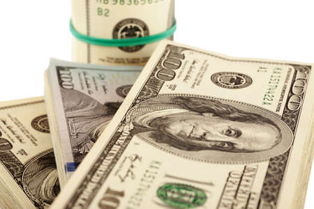 batch of dollars: US dollars isolated on white closeup, selective focus