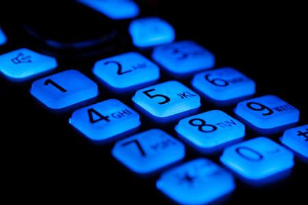 Phone buttons night blue backlight close-up macro shot, selective focusing Stock Photo