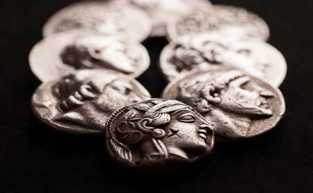 Ancient greek silver coins closeup macro shot, selective focus