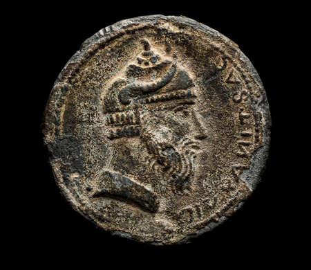 Ancient coin with head isolated on black, top view Stock Photo
