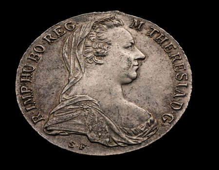 thaler: Maria Theresa silver thaler isolated on black, angle shot