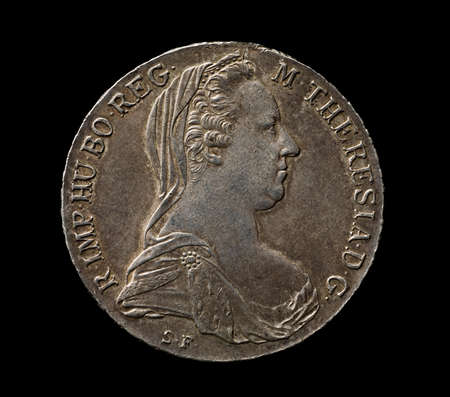thaler: Maria Theresa silver thaler isolated on black, closeup, top view