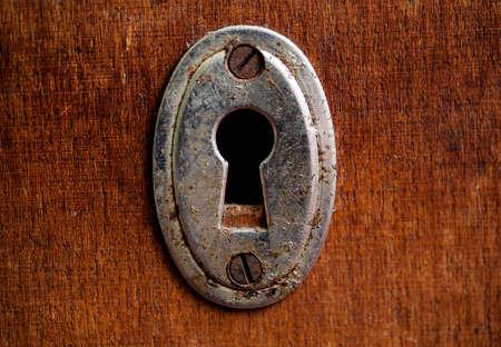 Vintage rusty keyhole closeup shot, selective focus