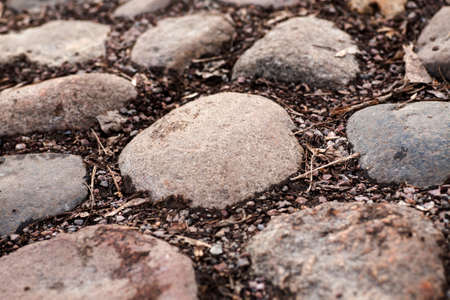 cobblestone road: Cobblestone road fragment with big stones closeup shot, selective focus Stock Photo