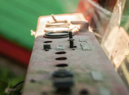Control elements on rusty metal dashboard, selective focus