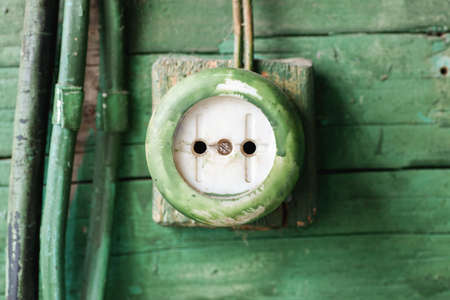 electric outlet: Old electric outlet on wooden wall, closeup Stock Photo