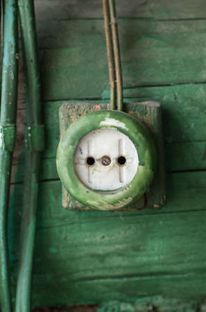 electric outlet: Old electric outlet on wooden wall, vertical