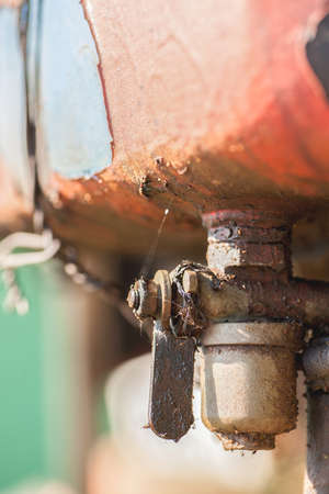 Dirty metal fuel tap, closeup shot selective focus