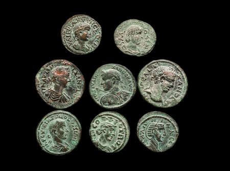 relic: Pile of ancient roman copper coins isolated on black, overhead view Stock Photo