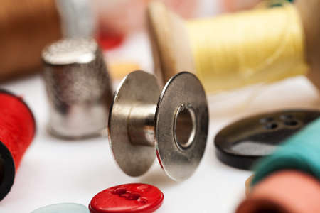 messy clothes: Thread spools, thimbles and other items for sewing close-up shot