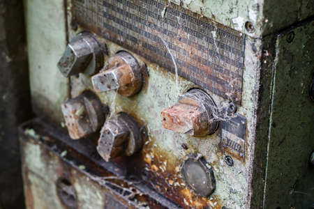 antique factory: Old rusted control elements with dirt and spider web