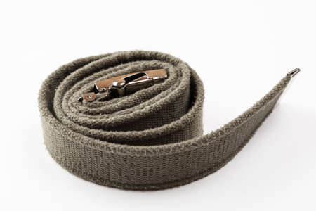 Green textile military belt on a white background Stock Photo